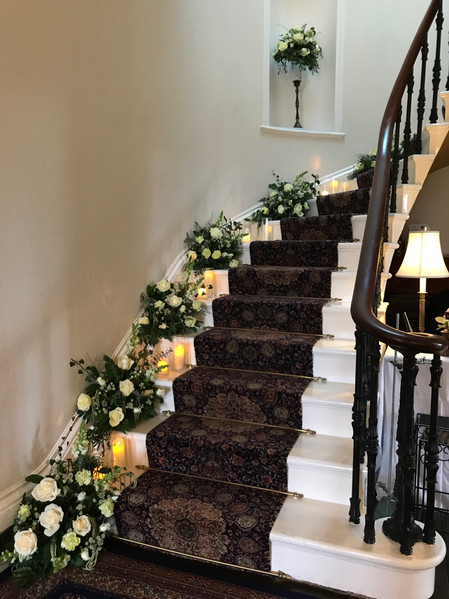 Wedding staircase flowers