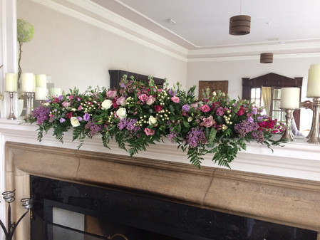 Wedding flowers Fireplace mantle arrange