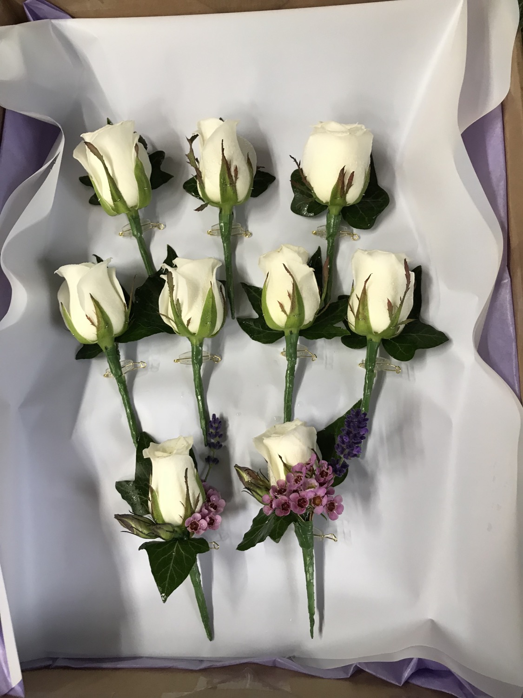 Ivory rose buttonhole