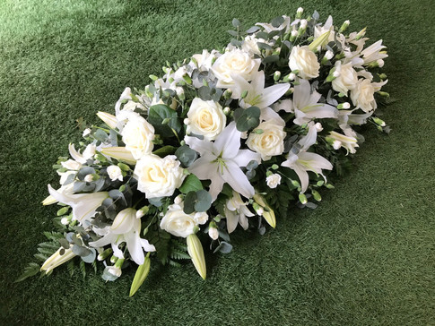 White lilly, rose and carnation coffin spray