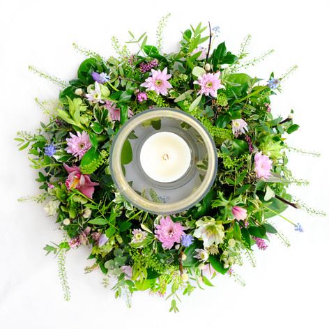 Large rustic round table centre with hurricane vase