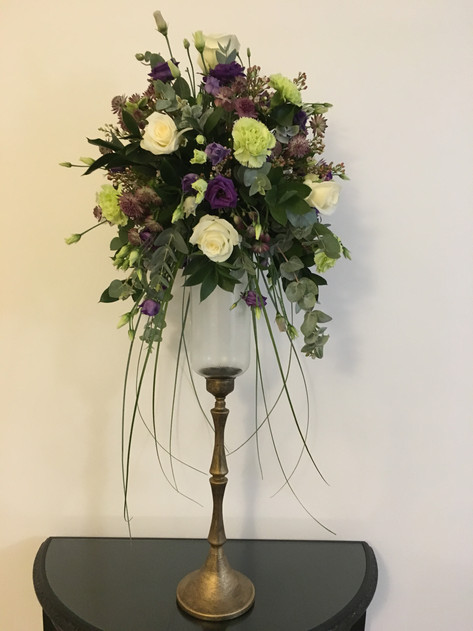 Tall purple and white flower arrangement