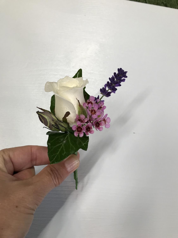Ivory rose lady's buttonhole