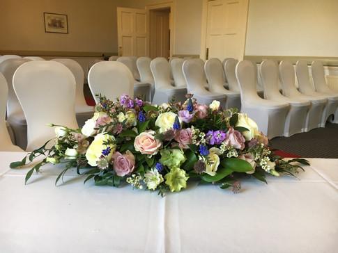 Wedding flowers top table flowers
