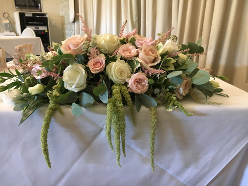 Wedding flowers Blush and white top table flowers