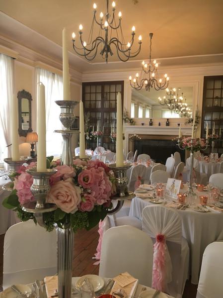 Wedding Flowers Pink roses on candelabra