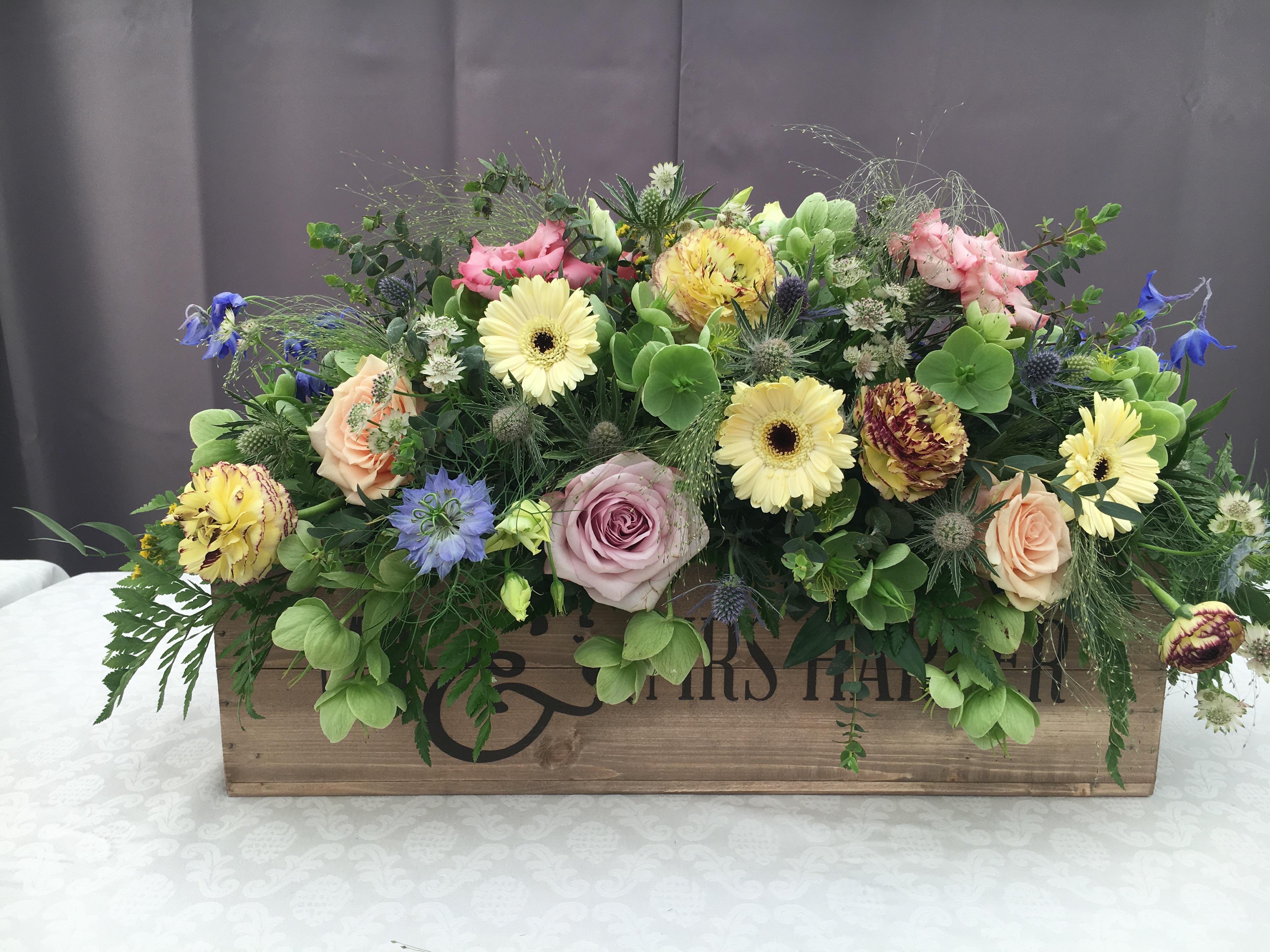 Rustic wedding top table arrangement