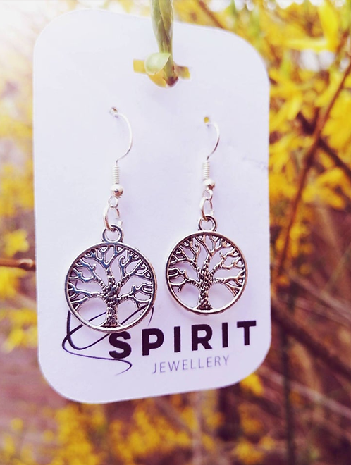 Tree of Life spiritual earrings with a holistic and natural background