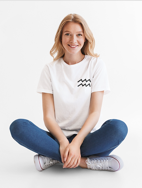 Woman modelling a white Aquarius Zodiac and spiritual T-shirt against a white background