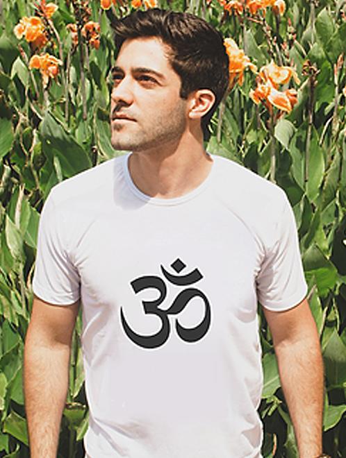 Man modelling a white spiritual Om t-shirt with spiritual symbol