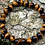 Tigers Eye Bracelet placed on a rock - unisex gemstones