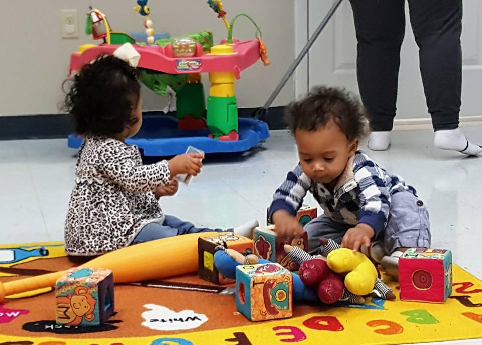 Mobile infants working on fine motor