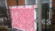 silicone mould being made from original cast iron railings