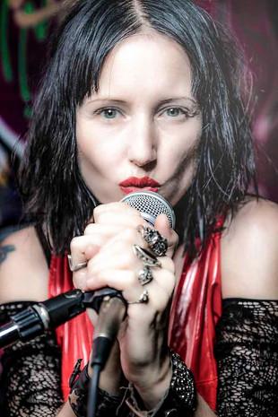 Seductive singer Vio of Suffer in Paradise