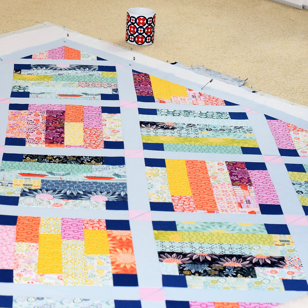 All quilt layers stretched and ready to go!