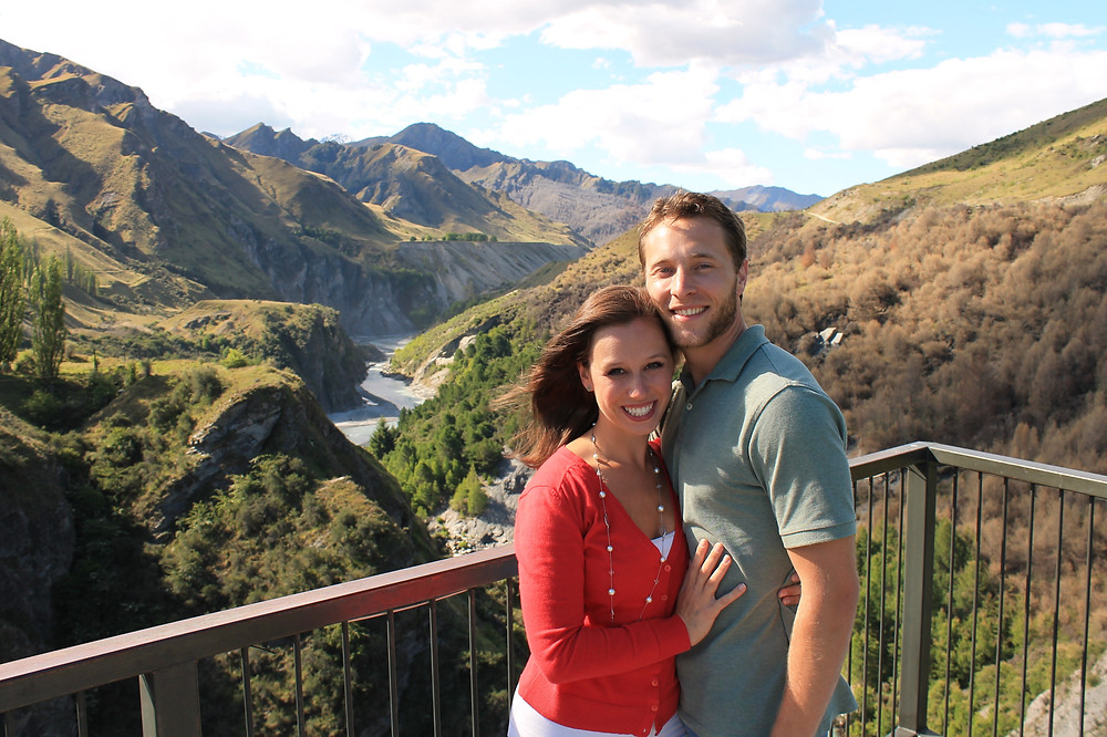 Cait and Andrew from Cait Without Borders in New Zealand after Skippers Canyon jet boat adrenaline fix