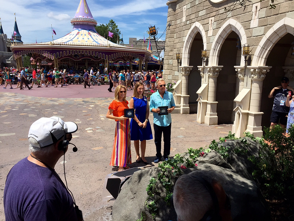 Disney Ambassador, Caitlin Busscher, filming a segment for Wheel of Fortune with Pat Sayjack and Vanna White at Magic Kingdom