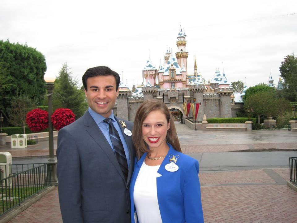 Disneyland castle with Walt Disney World Ambassadors Nathaniel Palma and Caitlin Busscher