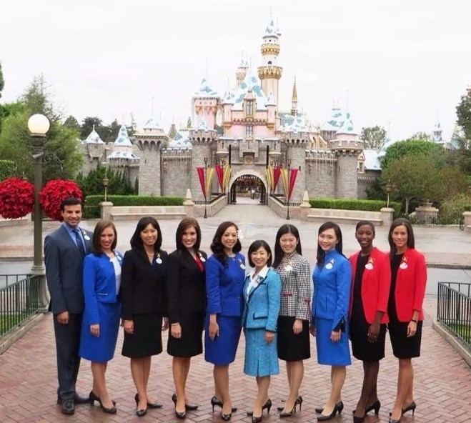 Disney Ambassadors in front of Sleeping Beauty Castle in Disneyland
