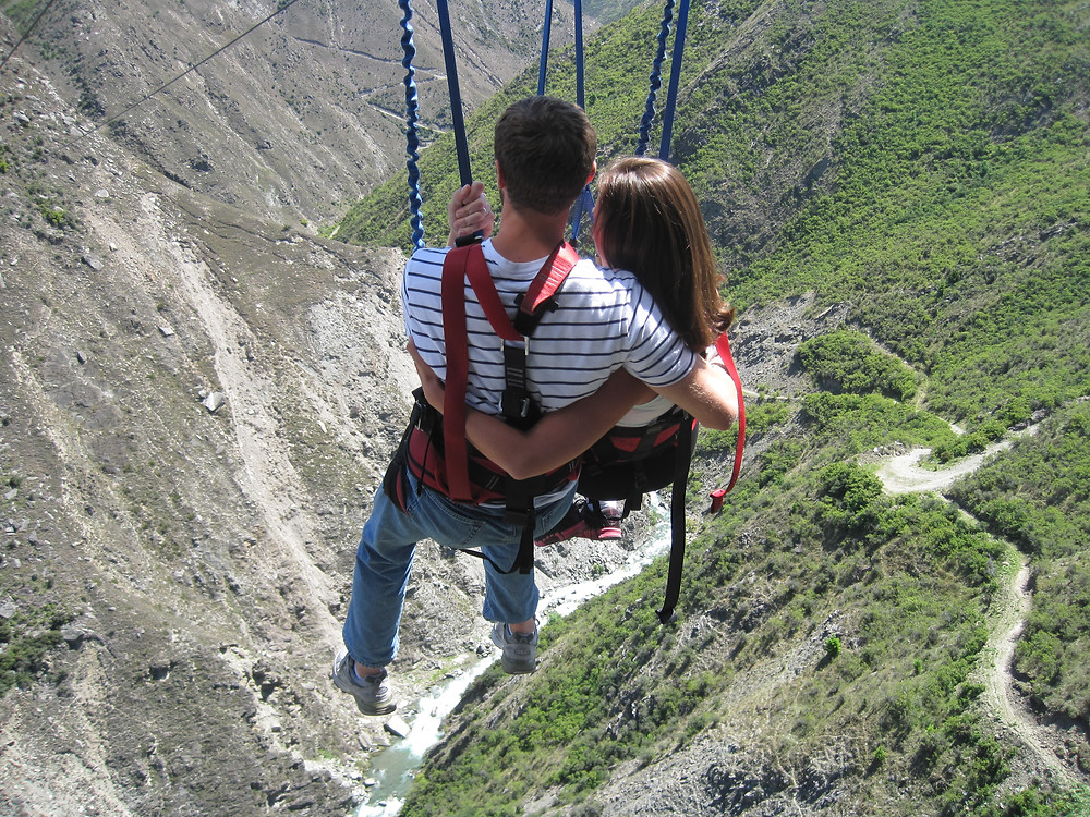 Adrenaline Fix: Couple hanging at the Nevis Swing at A.J. Hackett Bungy in New Zealand
