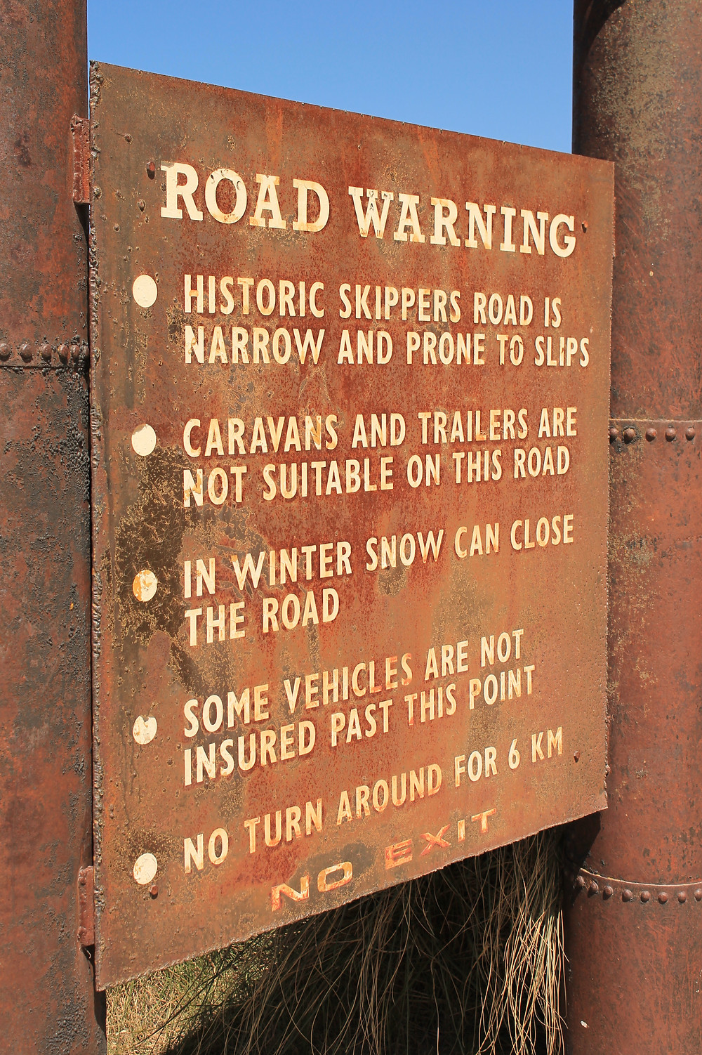 Warning sign on Skippers Road en route to Skippers Canyon jet boat adrenaline fix