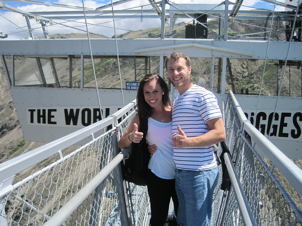 Couple smiling at the Nevis Swing at A.J. Hackett Bungy in New Zealand