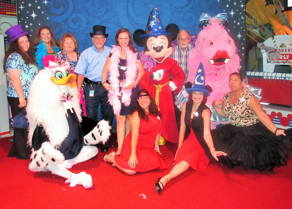 Disney managers with Mickey Mouse and characters from Fantasia.