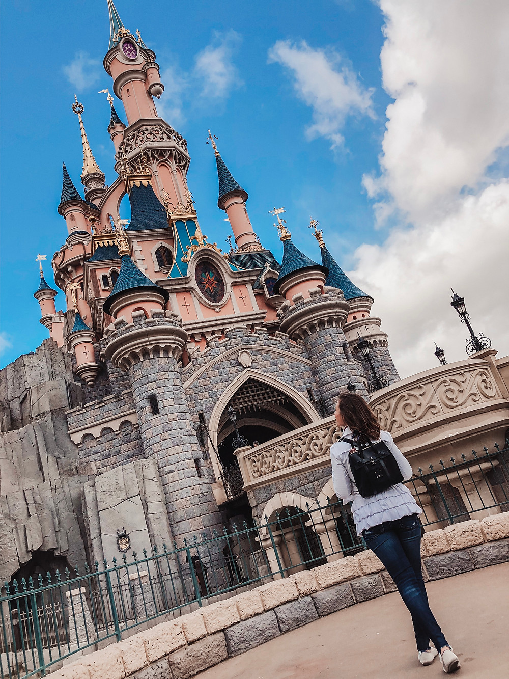 Caitlin Busscher in front of her 6th and final Disney castle in Disneyland Paris