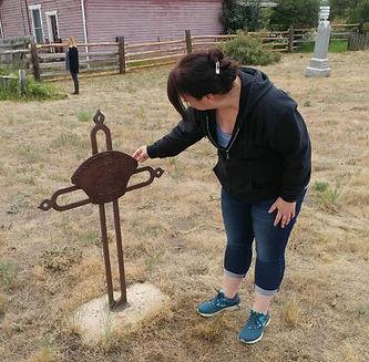 Blair inspecting grave marker.jpg