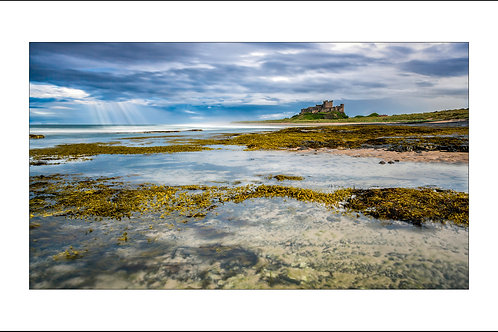 Ray's of Light over Bamburgh Castle