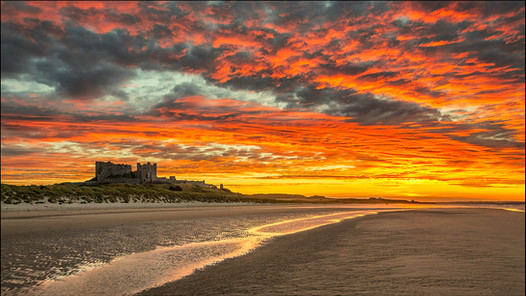 Fire in the sky over Bamburgh Castle