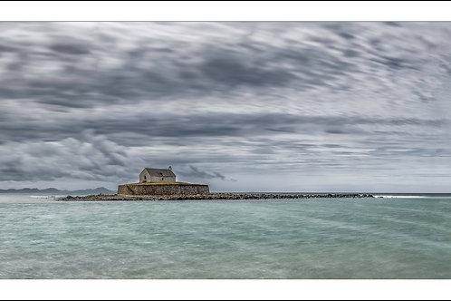 Storm approaching over St Cwyfan's Church, Llaneilian. print