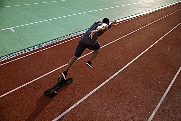 young-african-male-runner-running-on-rac