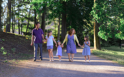 Family holding hands and walking