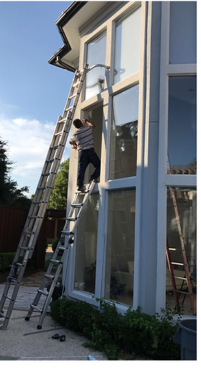 That's us in action - replacing a large window piece of glass  on second level