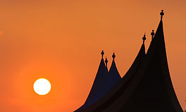 Best sunset over silhouetted Minangkabau minaret style roof.