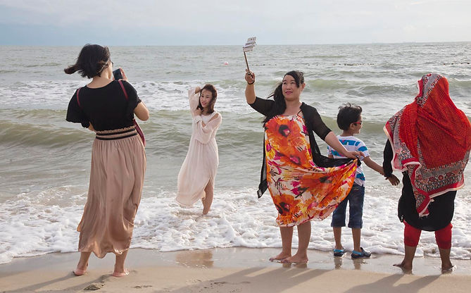 Tourists enjoy the Port Dickson beaches