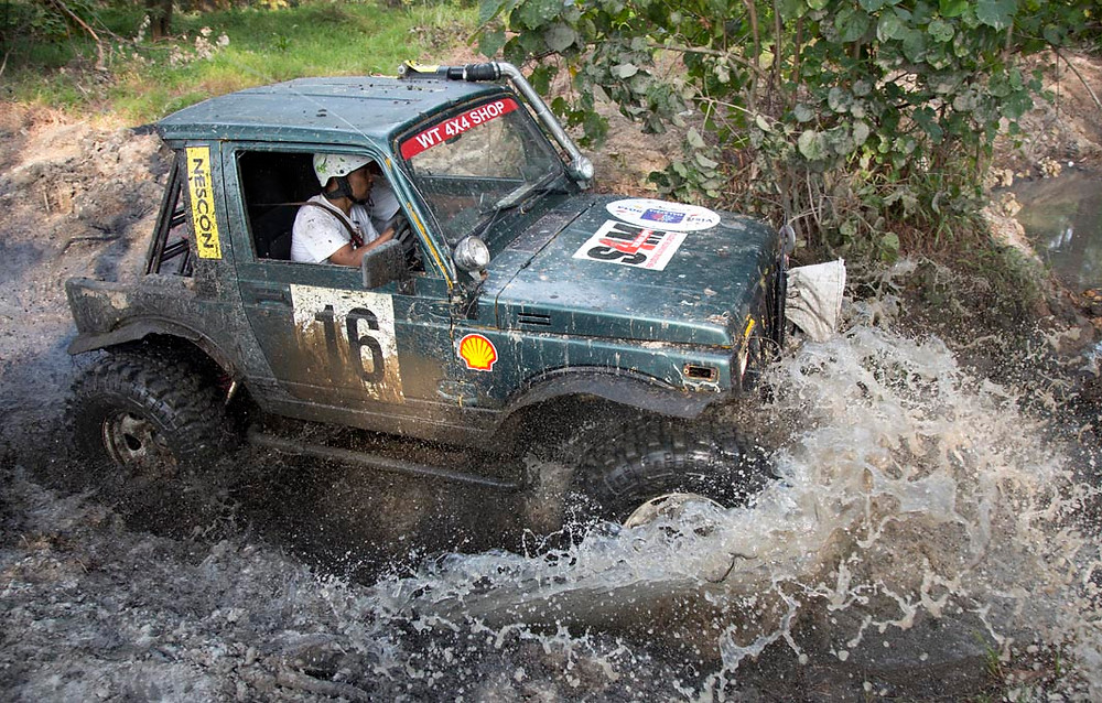 A competitor finds himself in a deep pool of mud and water in the Challenge in 2014.