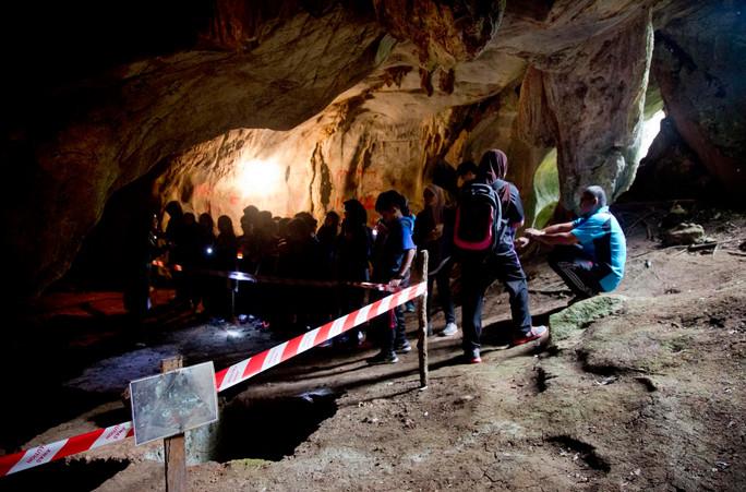 School children explore caves at Pasoh
