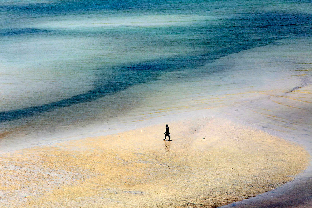 serembanonline photograph of a man walking along a beach at Tanjung Tuan, near Port Dickson by photographer Nic Falconer
