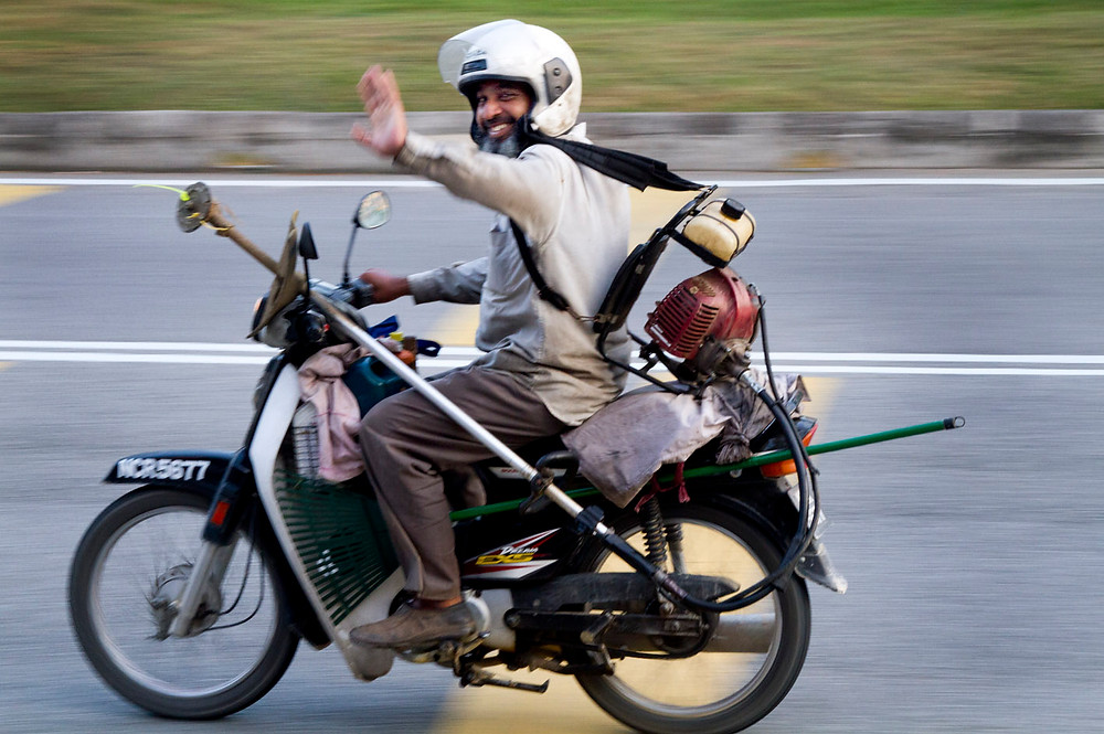 serembanonline photograph of a gardener on a motorcycle looking for work by photographer Nic Falconer