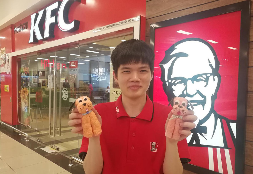 serembanonline.com photograph of Daniel who is autistic and works at KFC who have a program to employ autistic workers by nicaliss nic falconer