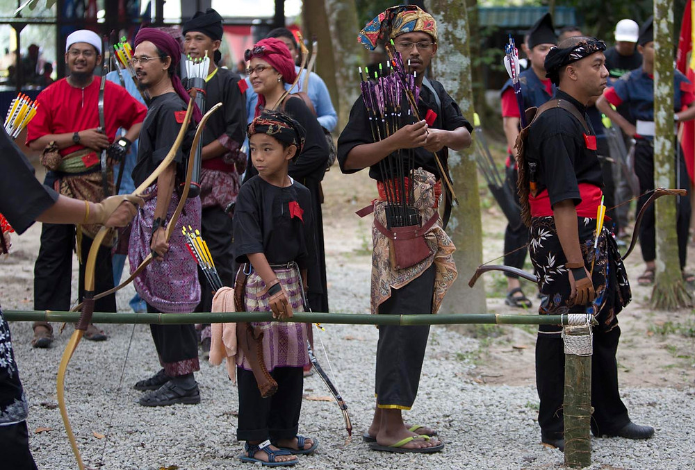 serembanonline photograph of archers in traditional costumes by nic falconer nicaliss
