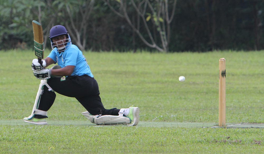 serembanonline photograph of a cricket match and NS Teachers Team batsman Zaid  by photographer nicaliss Nic Falconer