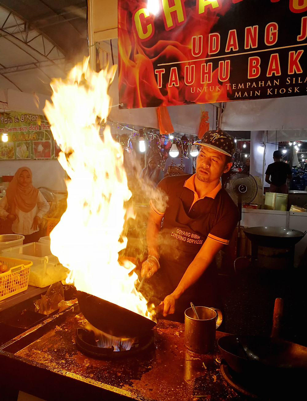 Photograph of the Malay Thai Food Festival at Paroi sports complex of Char Kuay Teow being cooked, taken by Nic falconer nicaliss of serembanonline