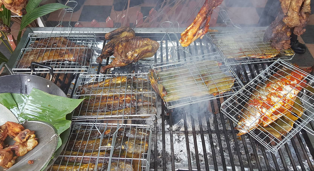 serembanonline photograph of  duck, chicken and fish being smoked traditionally with coconut husks by Nic Falconer nicaliss