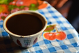 coffee cup on cloth.png