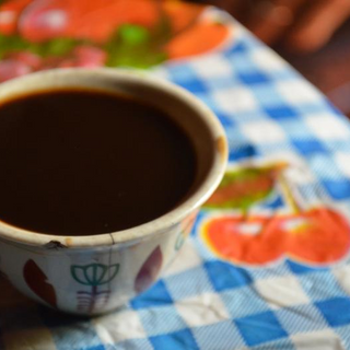 Ethiopian Education Fund Coffee Cup on Cloth