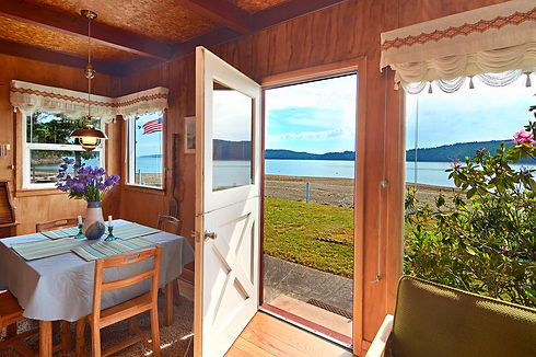 Vacation Homes on Hood Canal Little Red Beach House View through Door