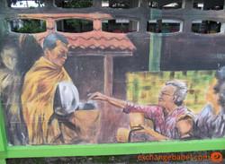 alms_round_murales_Loei_Thailand